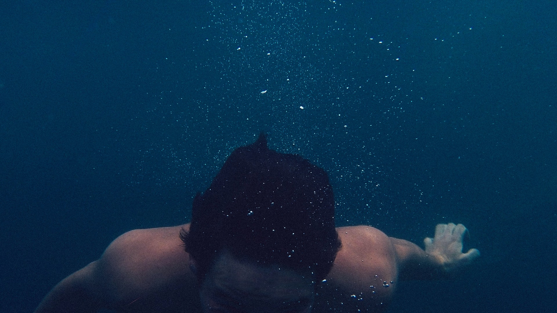 Man completey submerged in water