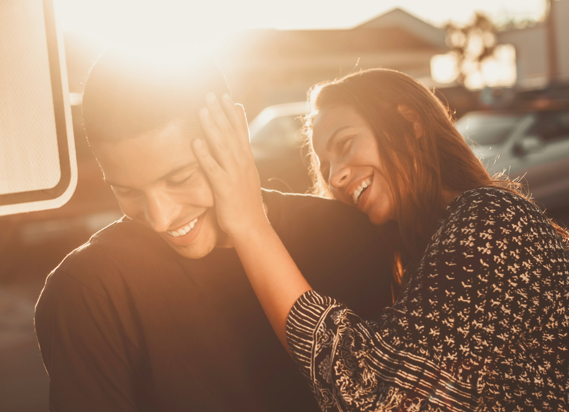 Couple smiling in the sun